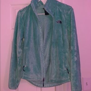 turquoise north face zip up jacket